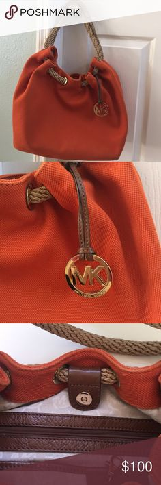 MK purse ❤️ Beautiful large  orange canvas MK bag with large cord closure! This bag is gently used, but in great shape!  Michael Kors Bags Shoulder Bags