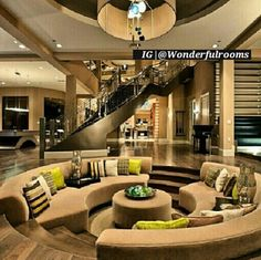 Luxury Living room interior design ideas. Round couch elevated flooring.