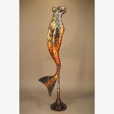 Mermaid sculpture upcycled by Brian Mock