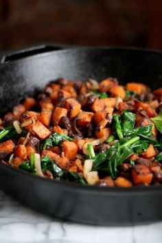 This healthy sweet potato hash recipe is packed with black beans, spinach, and Mexican spices. It's a perfect gluten-free breakfast idea with a fried egg.