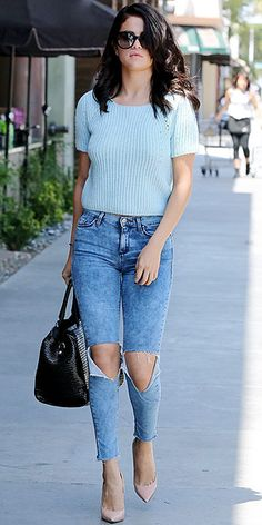 Love Her Outfit! | SELENA GOMEZ | Are you having flashbacks to the '90s? Selena's Topshop cropped sweater and distressed stonewashed jeans feel totally #TBT, but with understated accessories (and not too many of them), somehow it works.