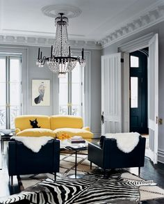 Black, white and yellow living room accented w/ zebra rug. #interior #design.  Note:  I'm really starting to dig grey and yellow together. @Cathy Obermeier via Lenee Hunziker