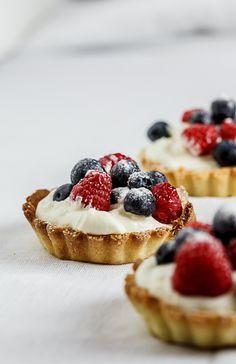 White chocolate tartelettes with fresh berries. #Recipe #Dessert #Summer