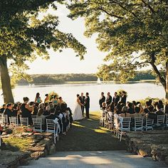 Brides.com: . By a Lake. While standing under a large tree might seem like the obvious choice, this couple has allowed two neighboring trees to define the ceremony space and create a natural frame. With little décor to compete with the view, guests can fully appreciate the beauty of the setting.