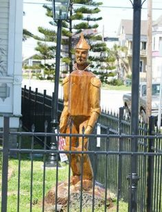 A James Phillips sculpture of the tin man is made of live oak and located at 17th and Winnie in Galveston.
