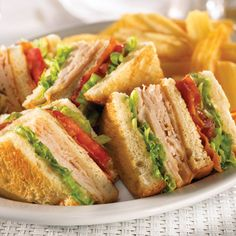 Copycat Denny's Club Sandwich  *6 slices toasted white bread *Mayo *6 oz deli-sliced turkey breast *4 iceberg lettuce leaves *4-6 slices cooked bacon *4 tomato slices ~Spread 1 1/2 tsp Mayo on 1 side of each toast.  Arrange turkey on 1 slice of toast. Place 1 lettuce leaf to fit over turkey.  Stack on another slice of toast w/Mayo side facing up.  Lay on bacon to fit on top of 2nd slice of toast. Arrange 2 tomato slices on top of bacon. Place 2nd lettuce leaf to fit on top of tomato. Top w/toast