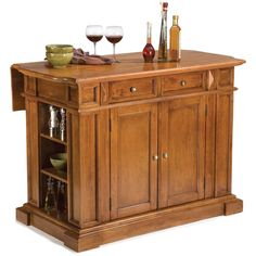 Lend a touch of elegance and a little extra cabinet space to your living space with this oak kitchen island. Constructed of solid hardwoods and veneers, it features a lovely distressed finish and antiqued brass hardware for a timeless look.