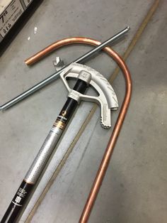 """Add a nice radius to a 1/2"""" copper tube by inserting a spring for a screen door and bending copper with a conduit bender. I did it all right in the aisle at Lowe's and didn't have to buy any tools!"""