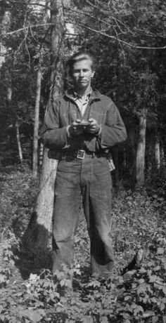 Enrollee standing in front of a tree, Camp Deer Lake, Civilian Conservation Corps :: Photographic Collections