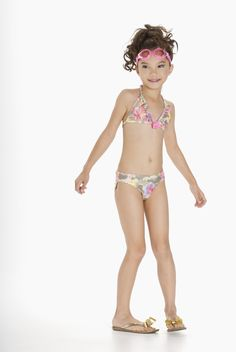 This flower print camouflage print bikini is perfect for every little trendsetter about to hit the beach. The tiny ruffle and flower trim adds just the right amount of girl-appeal. Swimsuits, Bikinis, Swimwear, Tween Girls, I Dress, Beachwear, Spring 2015, Flower, Camouflage
