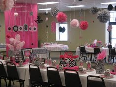 Pink, black and white decorations at a zebra baby shower #zebraparty #decorations