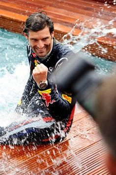 Race winner Mark Webber (AUS) Red Bull Racing climbs from the Energy Station Swimming Pool.  Formula One World Championship, Rd6, Monaco Grand Prix, Race Day, Monte-Carlo, Monaco, Sunday, 27 May 2012