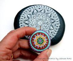 https://www.etsy.com/listing/264131057/hand-painted-stone-mandala?ref=listing-shop-header-0