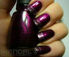 Dark polish with silver Konad tips