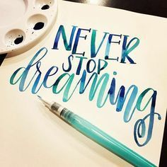 white sheet of paper, with the words never stop dreaming, written in blue waterc. - M collage - Ideen Watercolor Brush Pen, Watercolor Lettering, Lettering Tattoo, Watercolor Water, Calligraphy Letters, Modern Calligraphy, Caligraphy, Penmanship, Calligraphy Handwriting