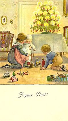 """""""Joyeux Noel!""""  Three children play on the floor with a nativity set.  A Christmas tree lit with candles is displayed on the table behind them."""