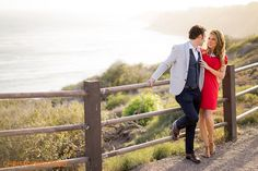 couple looking at each other during engagement session atop the bluffs in Palos Verdes