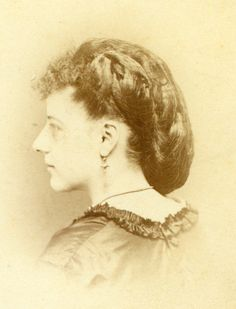 unusual hairstyle woman in profile, dated 1870 woman