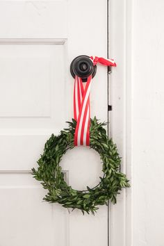 A simple and easy DIY for Christmas decor, this step by step guide will show you how to make this boxwood wreath. Simple, inexpensive, and a great Christmas craft for kids. See the full tutorial at www.pencilshavingsstudio.com