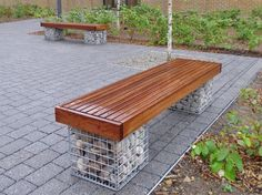 bench with small slats and timber fascias. Gabions filled with Scottish beach cobbles. Garden Seating, Outdoor Seating, Outdoor Projects, Garden Projects, Timber Bench Seat, Curved Bench, Gabion Retaining Wall, Gabion Baskets, Diy Garden Decor