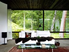 Lundnäs House is a summer house designed by Swedish architect Buster Delin for himself. The Lundnäs House is the architect's summer house. Cottage Design, House Design, Dark Ceiling, Wooden Pillars, Sweden House, Relax, Spacious Living Room, Living Rooms, Glass House