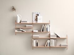 String Pocket is a compact and elegant shelf for books, collectables and other small items. Launched in 2005 by the Swedish manufacturer String, String Pocket is part of the popular collection designed by Nils Strinning in