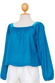 Light weight cotton blouse features sweet small ruffle along the square neckline. Handmade lace was crocheted on both sides of shoulder individually. Relaxed fit cotton top with long sleeves and elastic at the end is nice and easy.