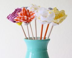 No Sew Fabric Flower Bouquet-Create a bouquet of fabric flowers that you don't even need to sew. Follow this tutorial from Dana Willard to create the fabric flowers with a glue gun and wooden dowels. Spray paint is optional!
