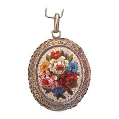 Lovely Roman Micro Mosaic locket depicting beautiful roses on a white ground. The oval Micro Mosaic is in perfect condition , there is no damage of