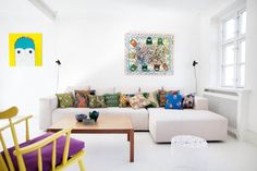 white couch + colorful pillows