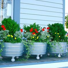 Galvanized Wash Tub Planters with wooden feet...perfect for the deck and they are seasonal!