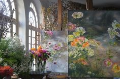 a glowing room in Claire Basler's chateau with a few of her extraordinary paintings
