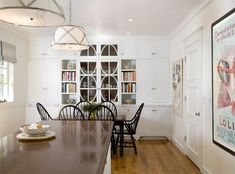 Suzie: Tish Key Interior Design - Open kitchen design with lots of built-in storage, black ...