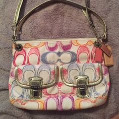 Coach limited edition Poppy Signature purse New without tags. Never been work/used. Comes with a long cross body strap as well as the short one. Not a single mark on the purse. Has one side pocket, then two phone size holders on inside. Has two buckle pockets on outside of the purse on the front! Colors on purse include blue, pink, purple, and some yellow. It has silver straps with silver buckles. Coach Bags