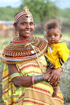Mother and Child from the Samburu tribe, Kenya, east Africa. Beading necklaces .