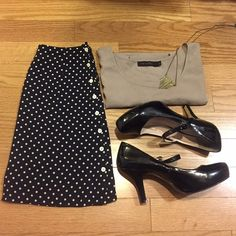 Banana Republic Polka Dot Skirt Flattering Banana Republic black and cream polka dot skirt.  Has buttons down seam for that extra umph to your look. Banana Republic Skirts A-Line or Full