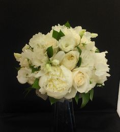 A fragrant bouquet of white peonies, garden roses, sweet pea, lisianthus and Israeli ruscus.  See more wedding bouquets, centerpieces, and more at www.jeffmartinsweddings.com