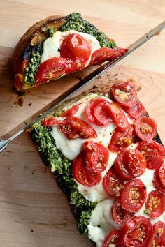 Take some bread of your choice, spread garlic butter on it, then pesto, then mozzarella and top it of with tomatoes. Put it in the oven and there you go :)