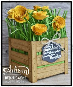 Flower Crate by Erica Cerwin,I was so inspired to create this project, I stayed up WAY too late! I think it was worth it! I used the Hardwood background stamp to create the crate, fringe scissors to create the grass and the Spiral Flower Die to create the flowers. Fun stuff! More details on my blog: http://pinkbuckaroodesigns.blogspot.com/2014/03/flower-frenzy-project-planner.html