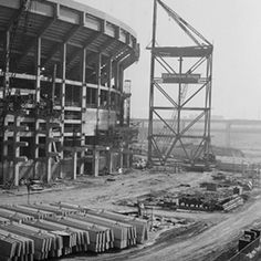 Three Rivers Stadium during construction, with sign for US Steel American Bridge Company, August 1969
