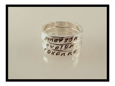 Name stamped rings. (Stackable) I would like these with the girls names on them for Mothers Day!