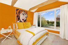 A invigorating splash of color to a contemporary bedroom.  Alexim Builders, Southampton, New York