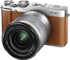 X-M1 16MP Compact System Digital Camera by Fujifilm /// just looks like a man' camera, doesn't it. Like a DSLR, but less bulky