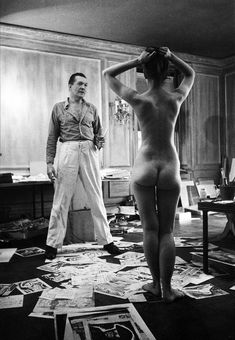 Artist/cartoonist Peter Arno, with model; photo by Stanley Kubrick.
