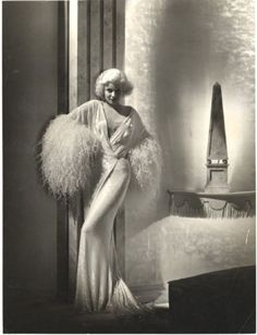 Jean Harlow, 1933 by Harvey White.  the wardrobe of the time is stunning enveloping the beauty