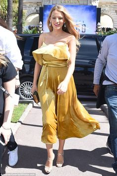 Golden girl: Blake Lively looked stunning for a luncheon with her Cafe Society co-stars on the French Riviera on Thursday