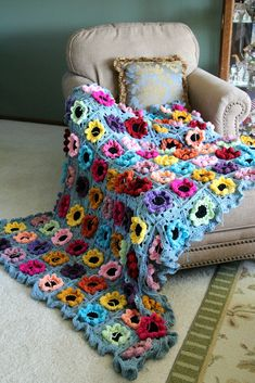 a row of sc, two rows of half double crochet , and then 3 half double crochets in each around makes a soft ruffled border
