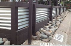 We decided to raise our sloping front yard by installing a retaining wall and fence. The corrugated metal and wood design is inspired by some of the houses I've seen in Cayucos, California. F…