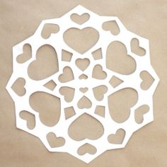 Follow this picture tutorial to make a 26 heart paper snowflake to honor the 20 beautiful children, and 6 heroic teachers of Sandy Hook.