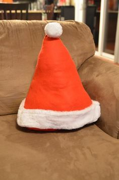 Seasonal decor -- turn 2 Santa hats into a throw pillow. From Dollar Store Crafts.